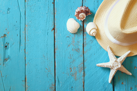 aqua background: top view nautical concept with fedora hat and seashells on aqua wooden background Stock Photo