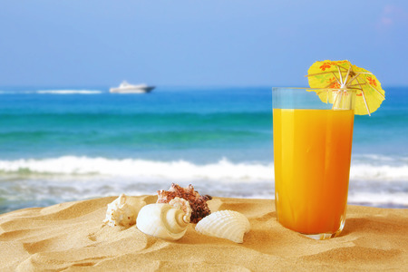 summer fruit: Image of tropical sandy beach, fruit cocktail and seashells. Summer concept Stock Photo