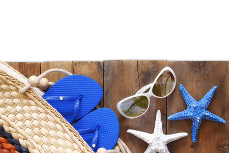 beach view: Top view of wooden deck with beach accessories. isolated on white