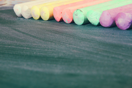 chalks: Top view of empty blackboard with colorfull chalks and chalk rubbed texture Stock Photo