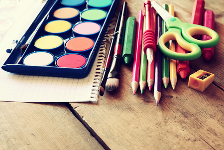 teaching crayons: Back to school concept. School supplies on wooden desk. selective focus
