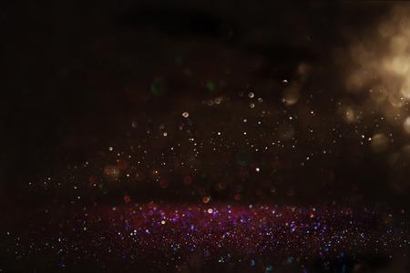 glitter vintage lights background. purple, gold and black. de-focused