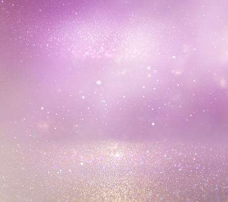 Pastel glitter vintage lights background. purple, pink and silver. de-focused Stock Photo