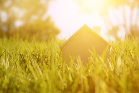 sweet background: Image of vintage wooden toy house in the forest, garden or park at sunlight morning. Retro filtered