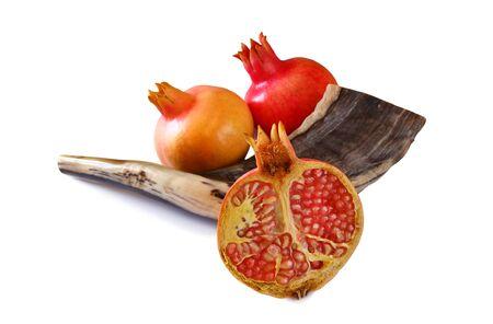 yom: Shofar (horn) and pomegranates isolated on white. Rosh hashanah (jewish New Year holiday) traditional symbols