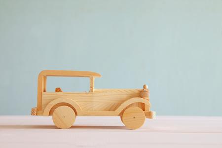 nostalgy: Vintage wooden toy car over wooden table. Vintage style image