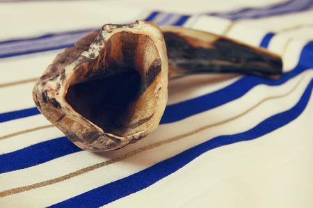 yom: White Prayer Shawl - Tallit, and Shofar (horn). Jewish religious symbols.