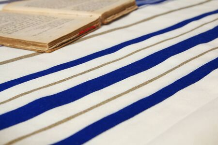 siddur: Prayer Shawl - Tallit, jewish religious symbol. Selective focus. Stock Photo