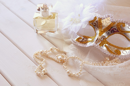 neckless: Vintage white venetian mask and pearls on table Stock Photo