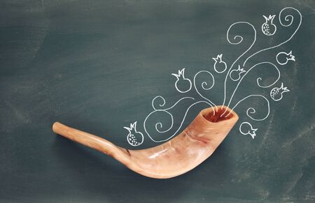 talit: Rosh hashanah (jewish New Year holiday) concept over blackboard with hand made illustrations. Traditional symbols