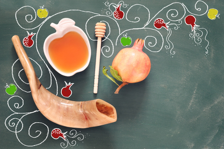 ha: Rosh hashanah (jewish New Year holiday) concept over blackboard with hand made illustrations. Traditional symbols