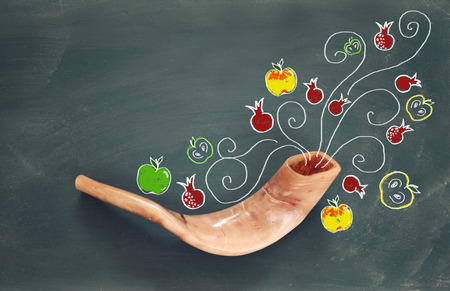 shofar: Rosh hashanah (jewish New Year holiday) concept over blackboard with hand made illustrations. Traditional symbols