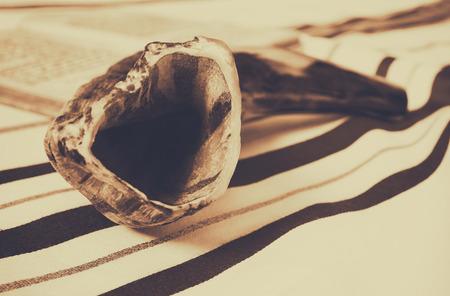 yom: Prayer Shawl - Tallit and Shofar (horn) jewish religious symbol. Sepia style filter