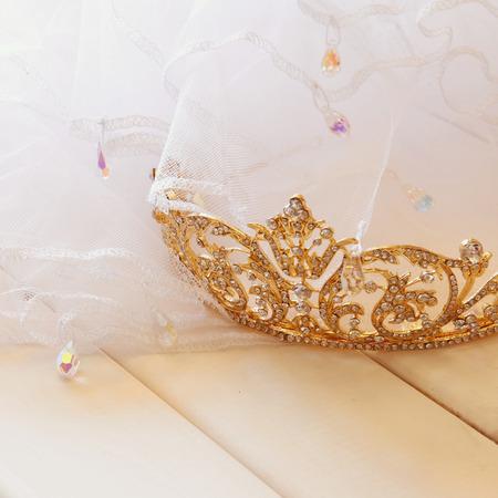 toilette: Dreamy photo of gold diamond tiara on toilette table. Selective focus