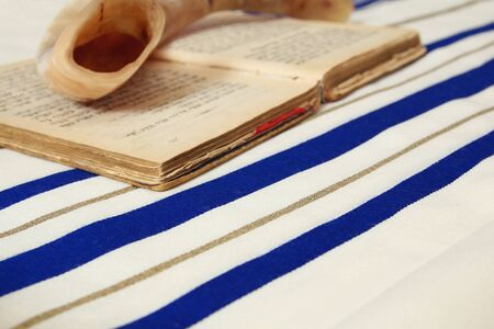 siddur: Prayer Shawl - Tallit, jewish religious symbol. Selective focus Stock Photo