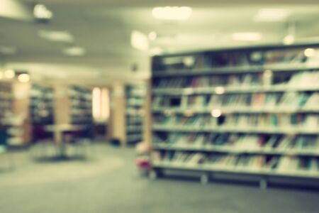 public library: abstract background of blured books in public library. retro style, image is blurred Stock Photo