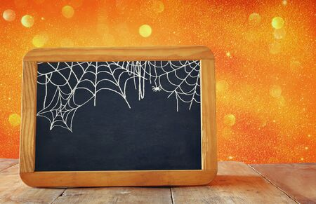 filtered: Abstract blurred glitter background and empty blackboard. Filtered image. Halloween concept Stock Photo