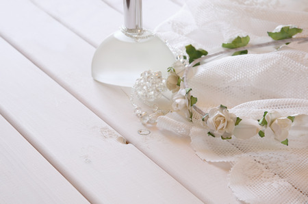 neckless: Crystal necklace, white floral tiara and perfume bottle on toilette table. Selective focus