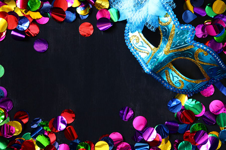 night background: Top view of venetian masquerade mask and colorfull confetti Stock Photo