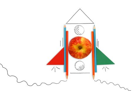 concept of idea and creativity. apple and pencils creating rocket. image is isolated.