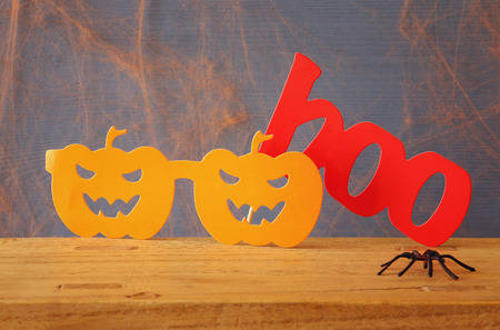 funny glasses: Halloween holiday concept. Funny paper pumpkin glasses. Stock Photo