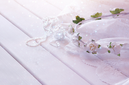 toilette: Dreamy photo of crystal necklace, white floral tiara on toilette table. Selective focus
