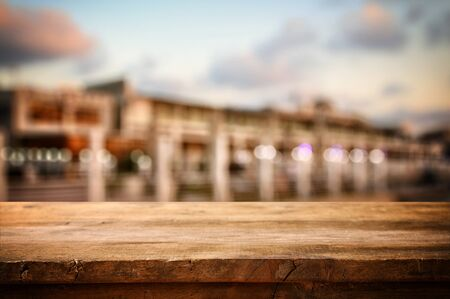 front view: Image of wooden table in front of abstract blurred background of restaurant view Stock Photo