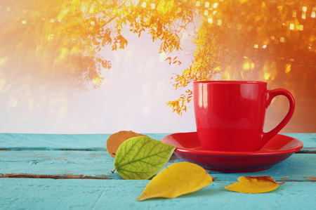 Autumn background with dry leaves and hot cup of coffee on wooden table Stock Photo
