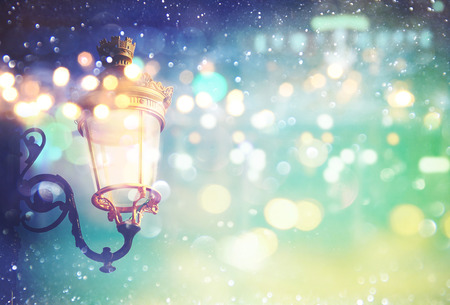 street party: Abstract and magical image of Christmas street lights with glitter overlay