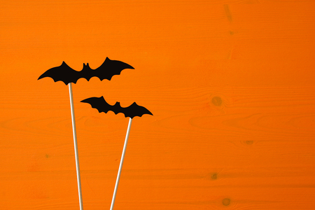 Halloween holiday concept. Funny paper bats.