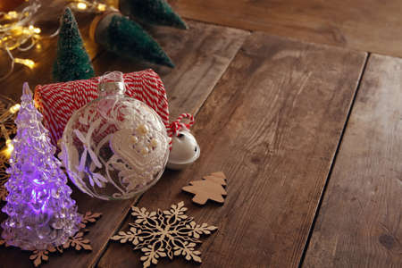 wood craft: Christmas concept. Decorative christmas tree next to decorations and craft supply. Selective focus