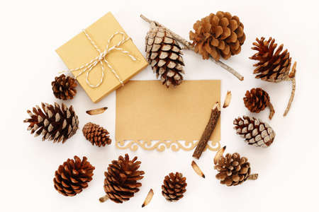 fir cones: Top view of pine cones, gift box and blank card on white background