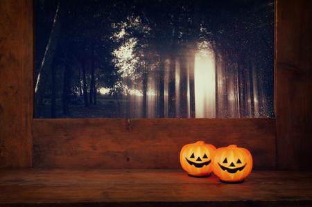 calabazas de halloween: Halloween holiday concept. Cute pumpkins on wooden table. Foto de archivo