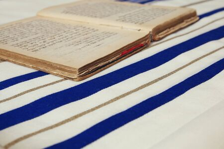 siddur: White Prayer Shawl - Tallit, jewish religious symbol. Stock Photo