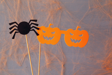 funny glasses: Halloween holiday concept. Funny paper pumpkin glasses and cute spider