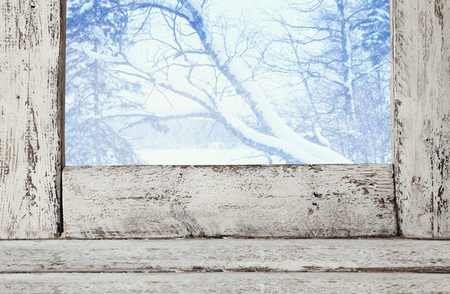 white window: Old window sill in front of dreamy and magical winter landscape background