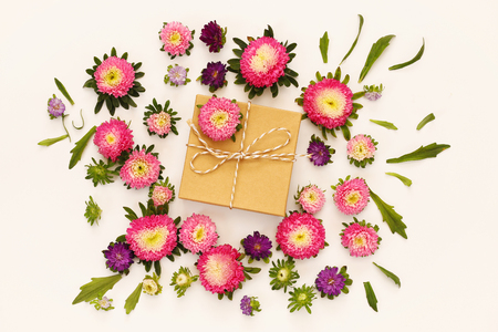 a hobby: Top view of beautiful flowers and gift box on white background Stock Photo