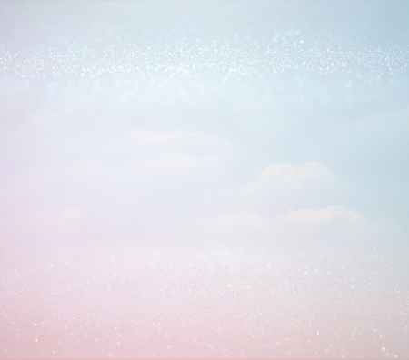 abstract photo of clouds burst in the sky. glitter overlay. Stock Photo
