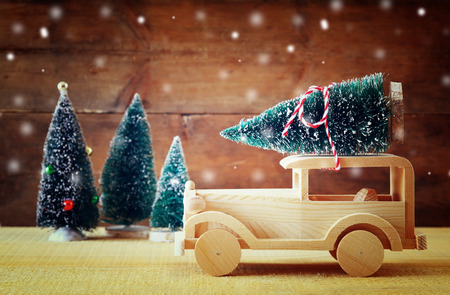 miniature: Wooden car carrying a christmas tree. Stock Photo