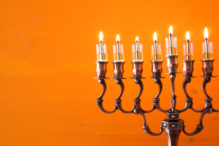 chanukiah: Image of jewish holiday Hanukkah background with menorah (traditional candelabra) and burning candles