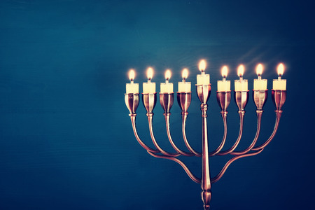 judaica: Image of jewish holiday Hanukkah background with menorah (traditional candelabra) and burning candles