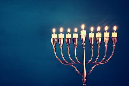 menora: Image of jewish holiday Hanukkah background with menorah (traditional candelabra) and burning candles