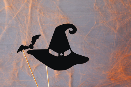 Halloween holiday concept. Funny paper witch hat and the bat Stock Photo