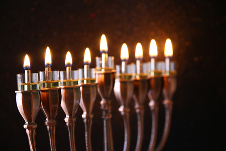 judaica: Selective focus image of jewish holiday Hanukkah background with menorah (traditional candelabra) and burning candles Stock Photo