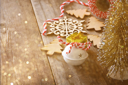 christmas vintage: Christmas concept. Decorative tree next to decorations and craft supply. Selective focus