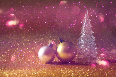 christmas light: Image of christmas glowing festive tree and ball decorations on glitter background Stock Photo