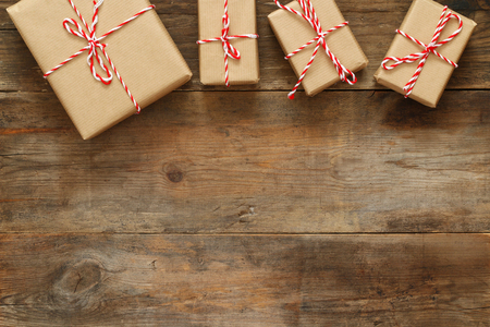 handcrafted: Flat lay image of handmade gift boxes over wooden background