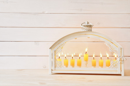 hanuka: Image of jewish holiday Hanukkah background with menorah (traditional candelabra) and burning candles