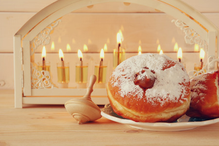 judaica: Selective focus image of jewish holiday Hanukkah with menorah (traditional Candelabra)