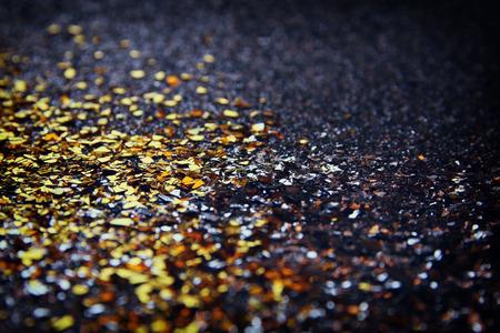 de focused: glitter vintage lights background. gold and black. de focused.